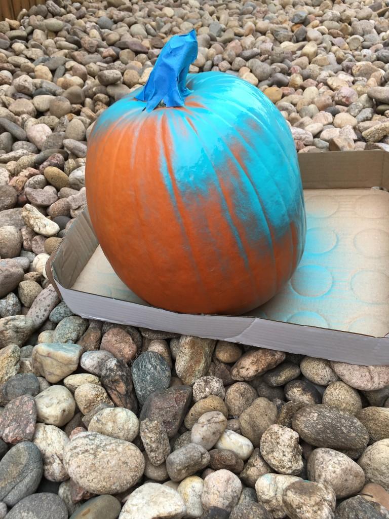 painting teal pumpkin